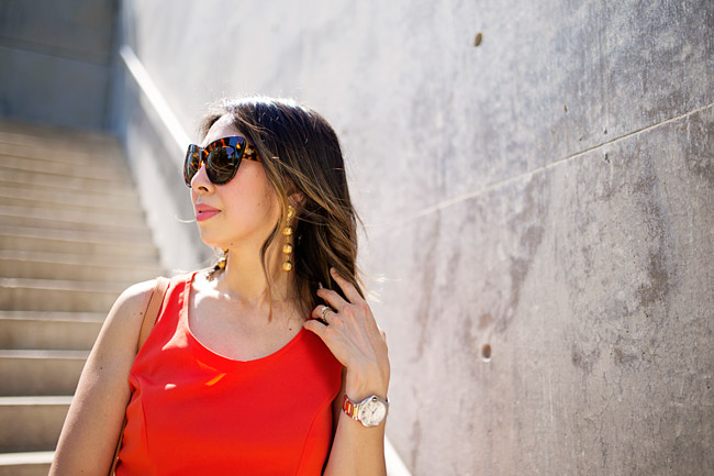 style of sam, vintage chanel drop ball drop earrings, orange jumpsuit, lob haircut with ombre color