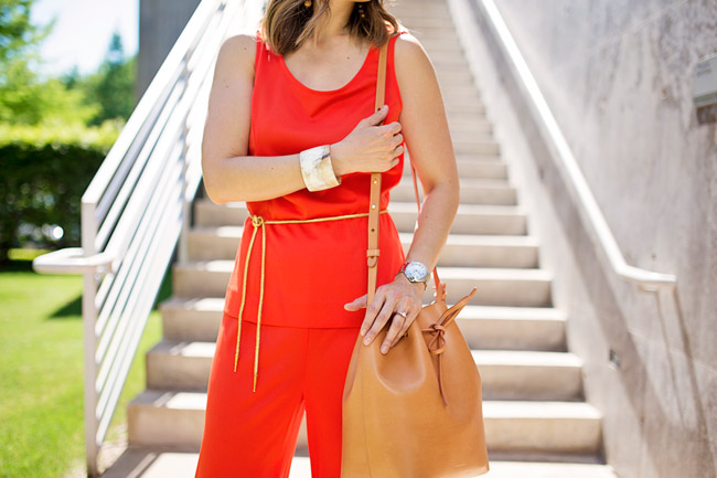orange jumpsuit with gold rope belt, mansur gavriel bucket bag in cammello and rosa, mai tai horn cuff