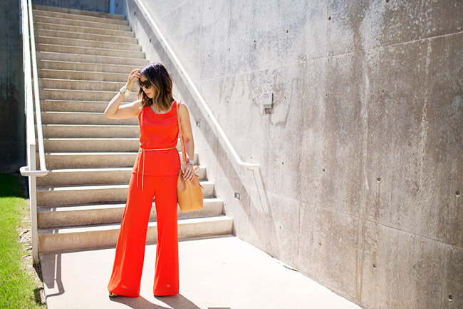 orange jumpsuit with gold rope belt, mansur gavriel bucket bag in cammello and rosa