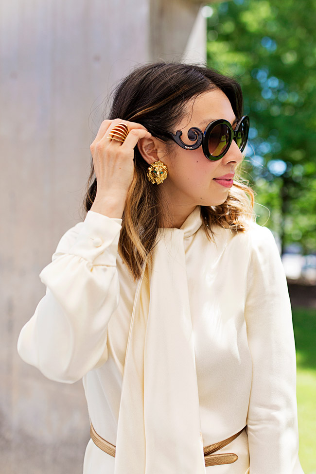 tie neck blouse, wide leg pant/trousers outfit, vintage jumpsuit, lion earrings, style of sam, from grandma with love, vita fede futuro ring, prada baroque sunglasses