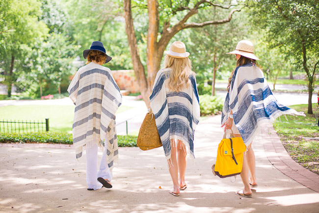 chic at every age, beach swimsuit coverup, how to wear a poncho, TOMS yellow backpack, gold metallic slides, pantropic straw hat, urban outfitters striped open poncho