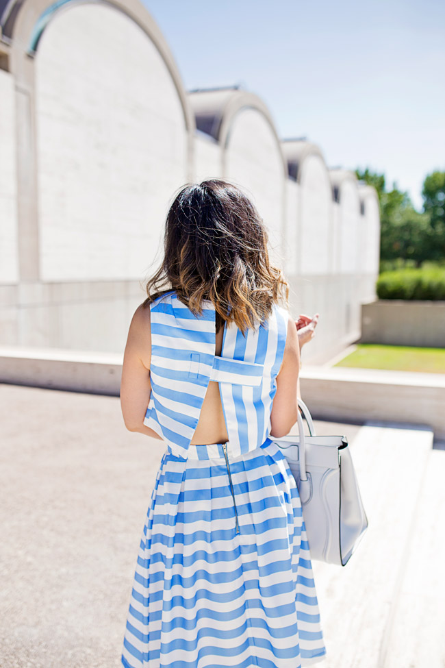 blue striped crop top and midi skirt matched set coordinates, yellow tassel earrings, retro modern style, how to wear a midi skirt, lob haircut with ombre highlights