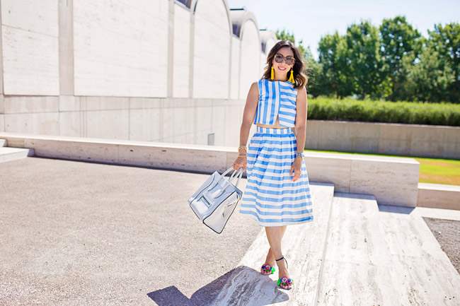 blue striped crop top and midi skirt matched set coordinates, yellow tassel earrings, sophia webster lilico floral heels, retro modern style, how to wear a midi skirt, white celine luggage tote