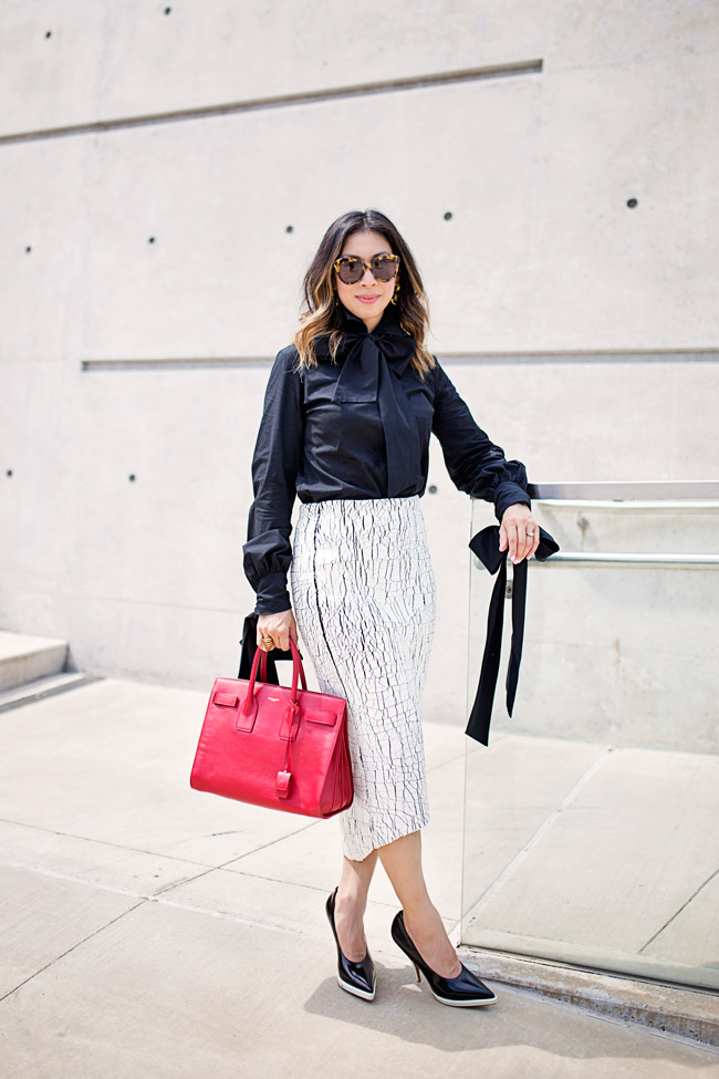 alexander mcqueen bow blouse, balenciaga cracked paint skirt, celine black and white pumps, saint laurent sac de jour in red, how to wear a white skirt pussybow blouse