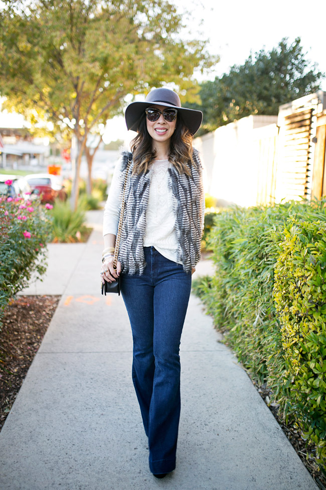 how to wear a faux fur vest, wool hat, flare jeans, how to get dressed fast, chanel boy bag
