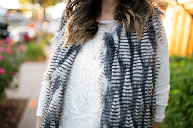 how to wear a faux fur vest, wool hat, flare jeans, how to get dressed fast