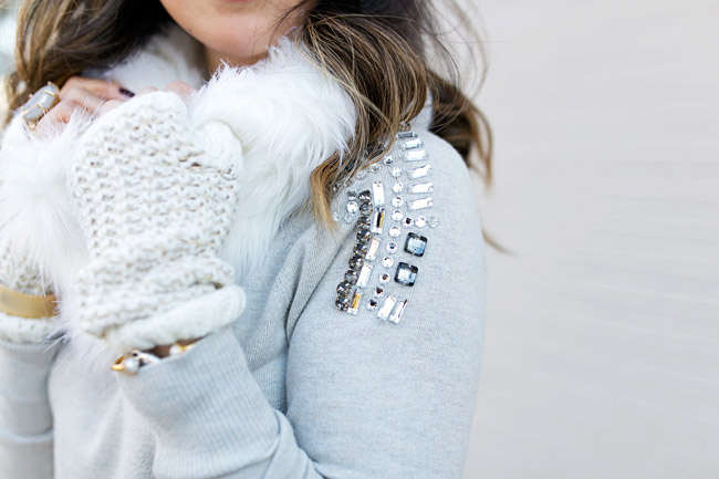 winter neutral outfit, how to wear a faux fur scarf, fingerless gloves, target embellished sweater