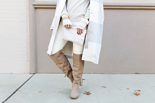 winter neutral outfit, how to wear a faux fur scarf, fingerless gloves, tassel riding boots