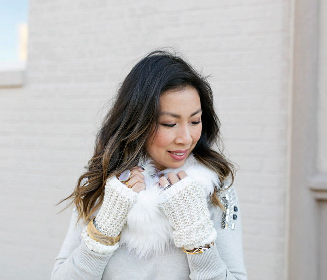 winter neutral outfit, how to wear a faux fur scarf, fingerless gloves