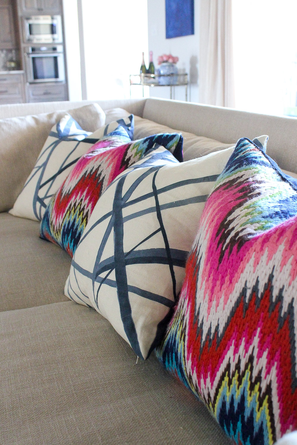modern glam zen living room, MGBW franco sofa, jonathan adler bargello pillows, kelly wearstler channels pillows