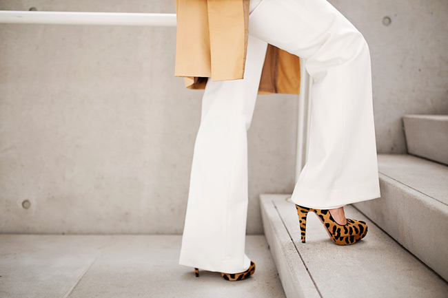 miu miu tan long leather jacket, cream wide leg pants, how to wear a long leather jacket, prada leopard platform pump