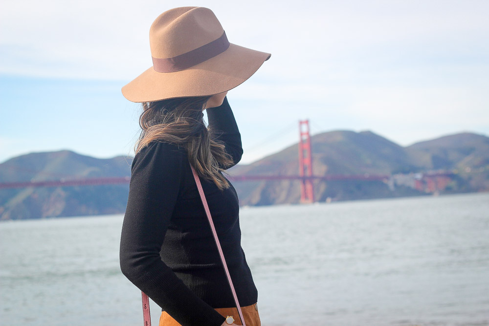faux suede button front skirt, Brixton hat, chloe faye pink bag, san francisco bridge, crissy field