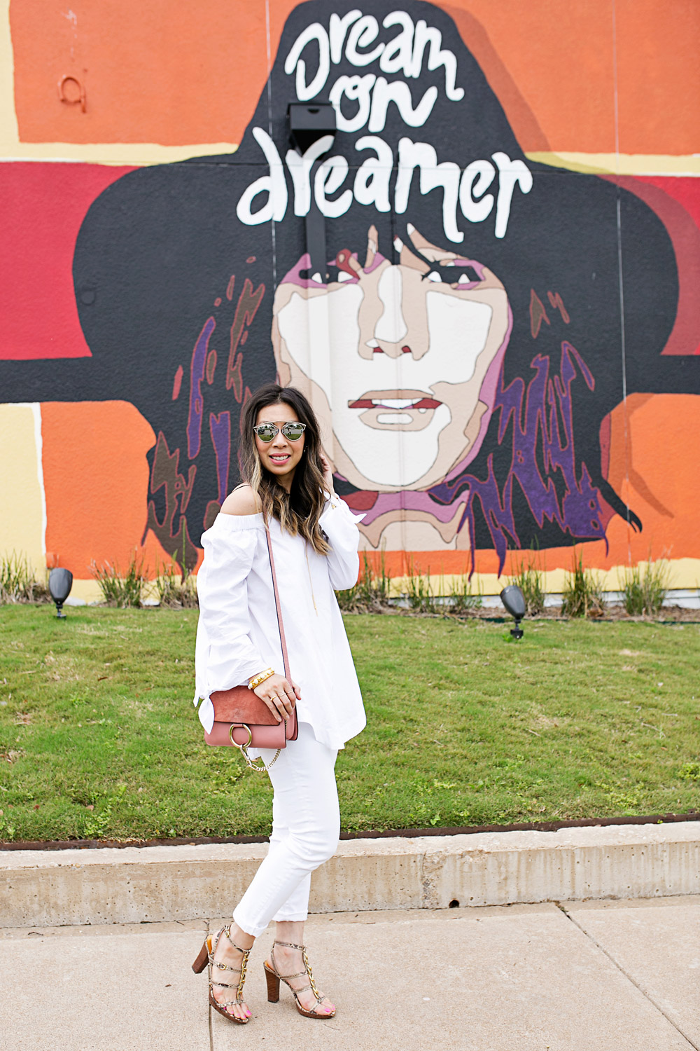 white off the shoulder top, dream on dreamer walls of fort worth, rose pink chloe faye bag, dior so real dupe sunglasses