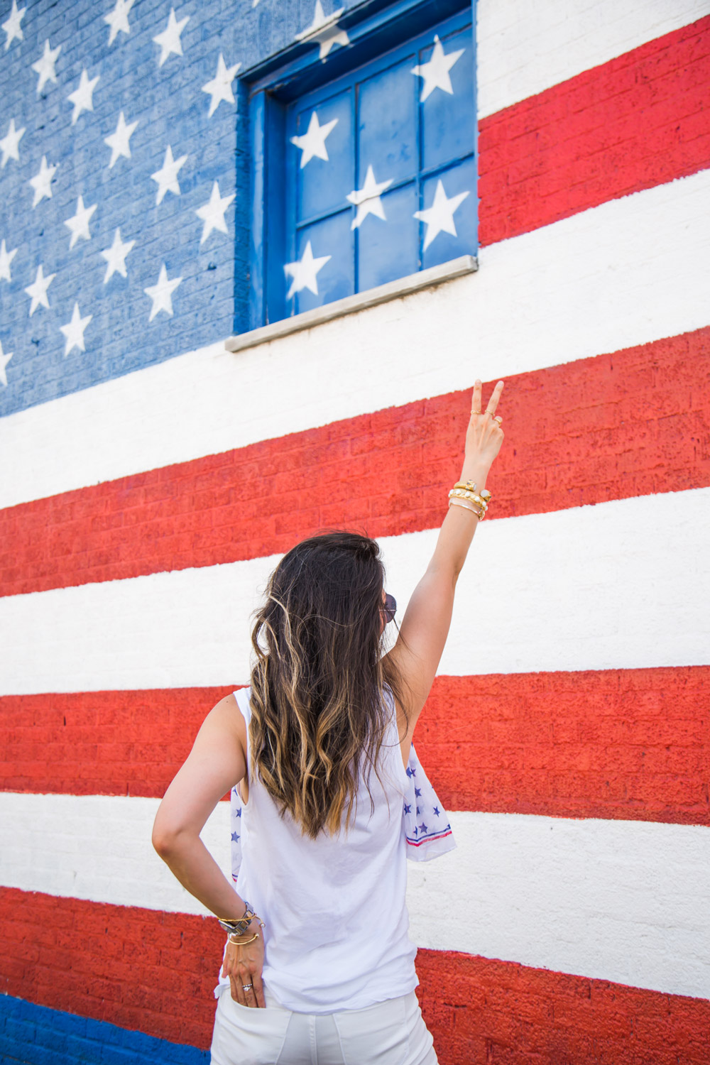 peace sign in front of american flag