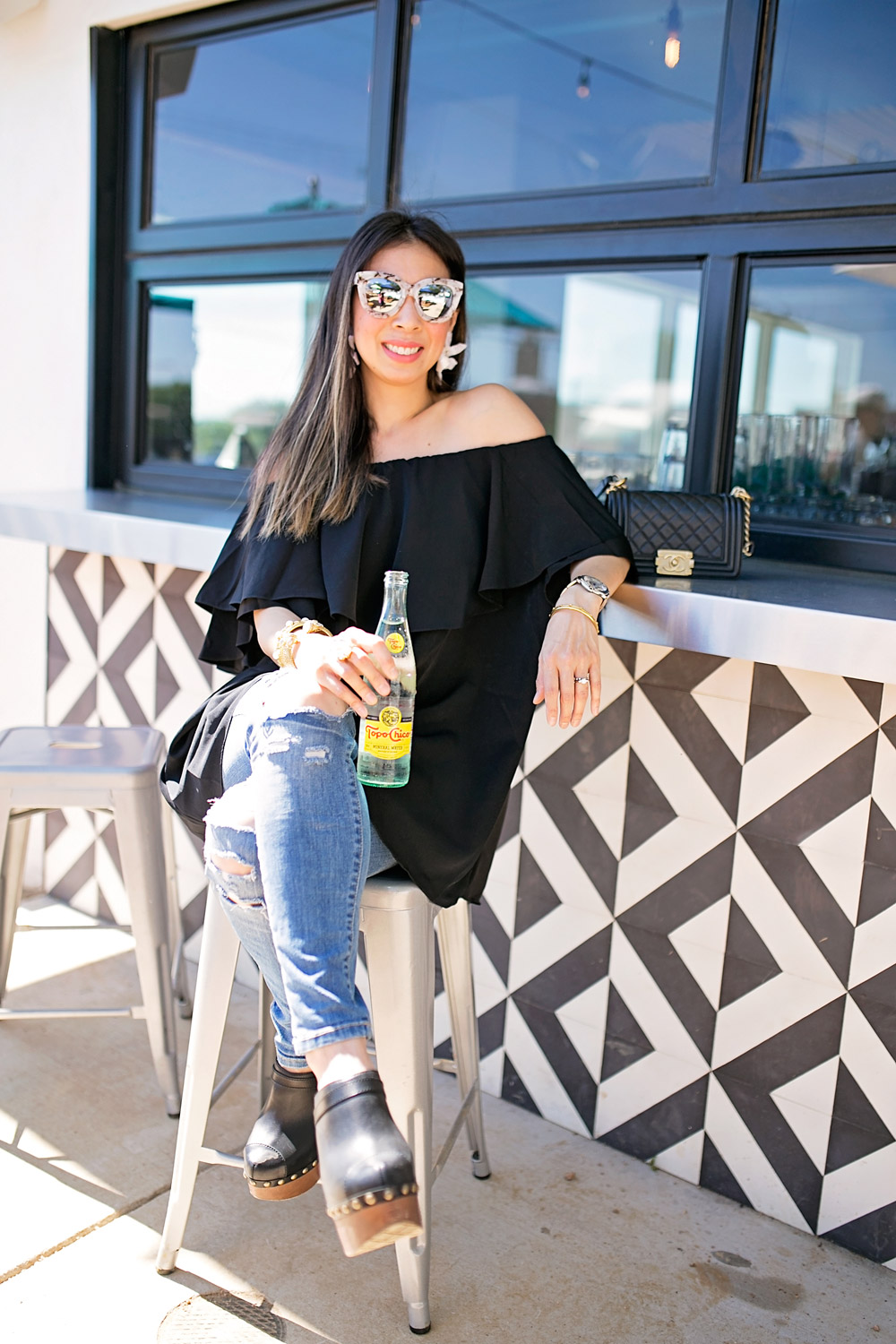 off the shoulder dress and ripped jeans at taco heads in fort worth
