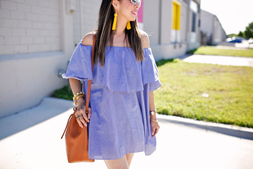 yellow tassel earrings with blue gingham off the shoulder dress