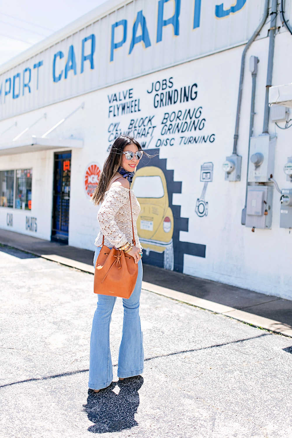 crochet off the shoulder top, flare jeans, mansur gavriel bucket bag in cammello rosa