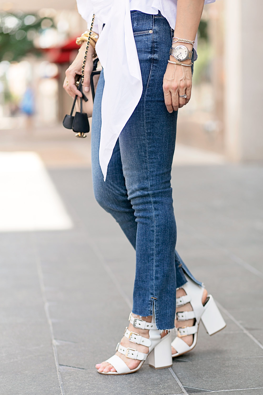statement sleeve top, uneven hem jeans, laurence dacade khloe sandals
