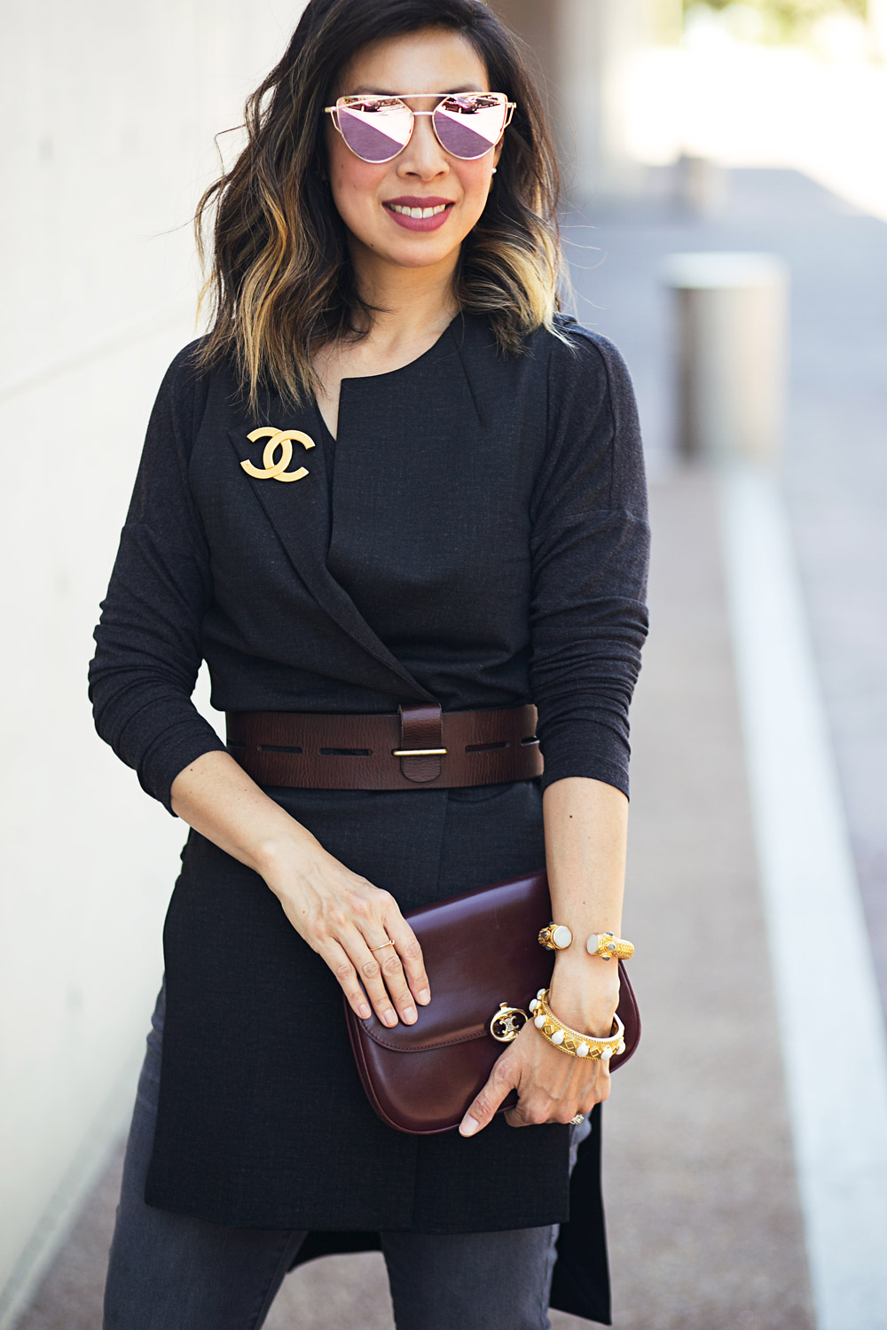 cabi drafting vest with chanel brooch and slim boyfriend jeans for a girls night out outfit