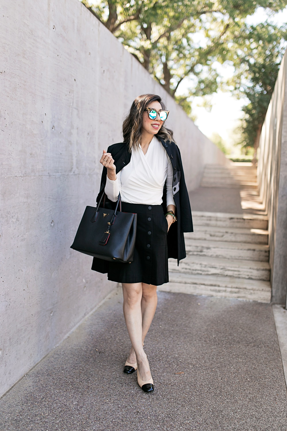 cabi wrap tee and utility skirt with chanel slingbacks for a black and white work outfit