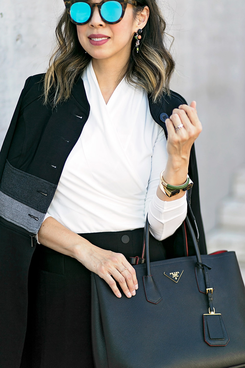 cabi wrap tee and utility skirt with convertible jacket for a black and white work outfit