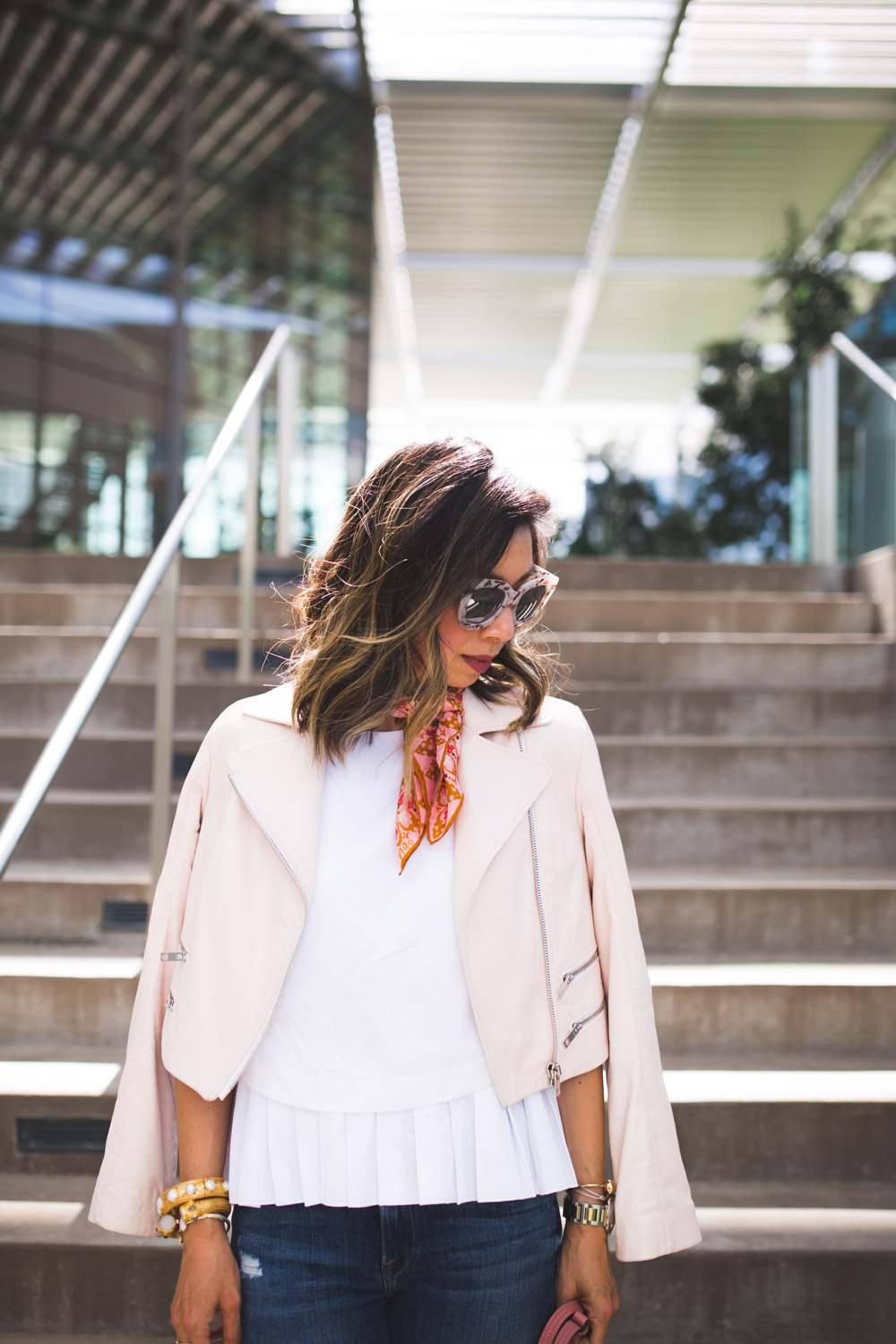 quay sugar and spice sunglasses, cuyana pleated top, rag and bone pink moto jacket