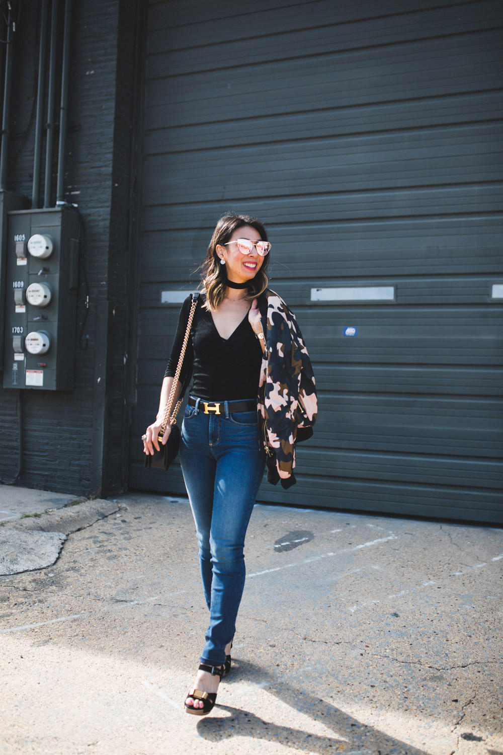topshop camo bomber jacket with black body suit, choker, and NYDJ skinny jeans
