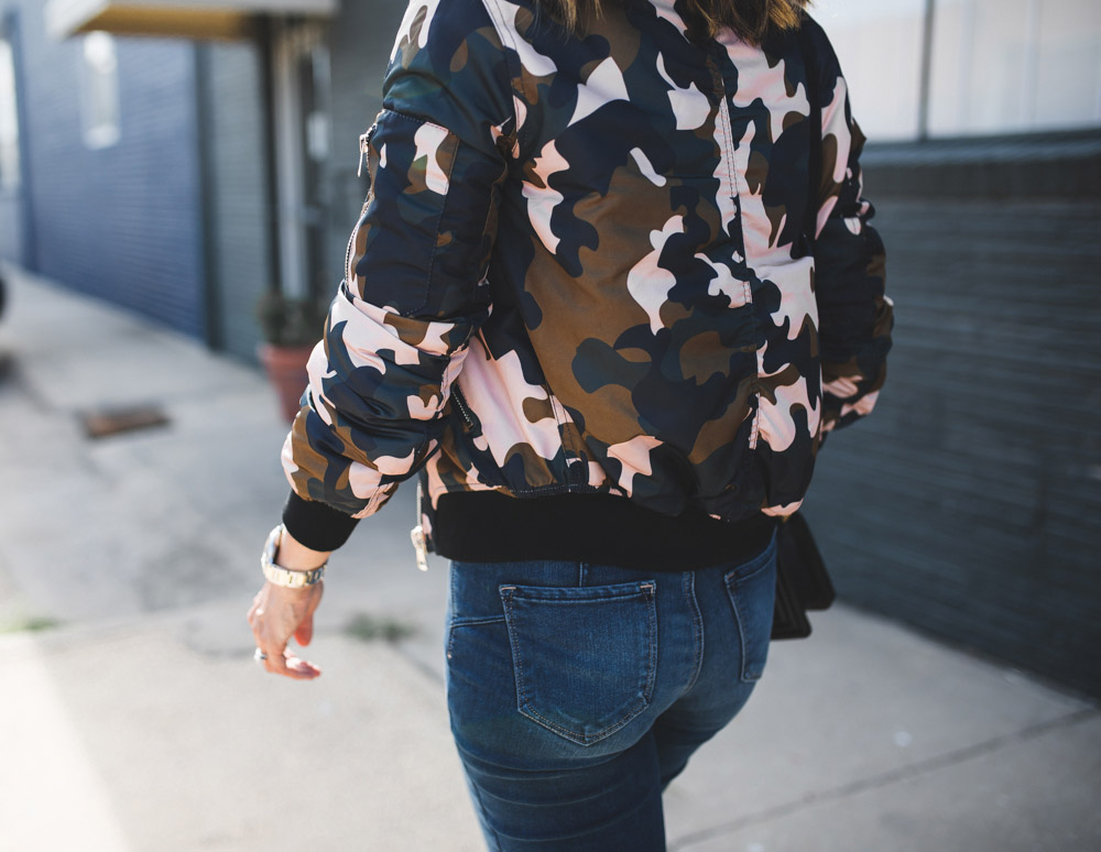 topshop camo bomber jacket and rear view of NYDJ uplift jeans