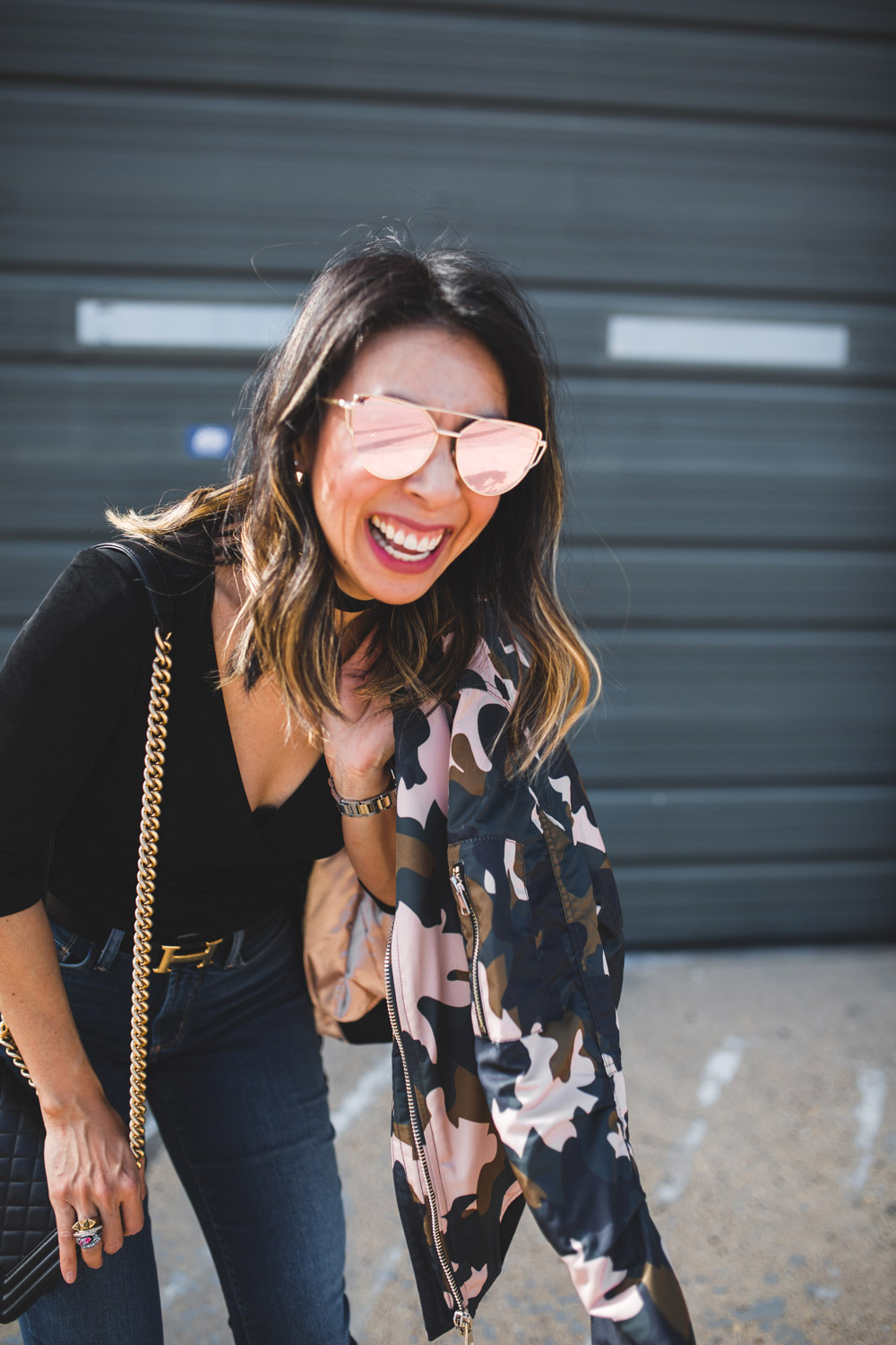 T+J rose gold sunglasses and happy girl blogger laughing