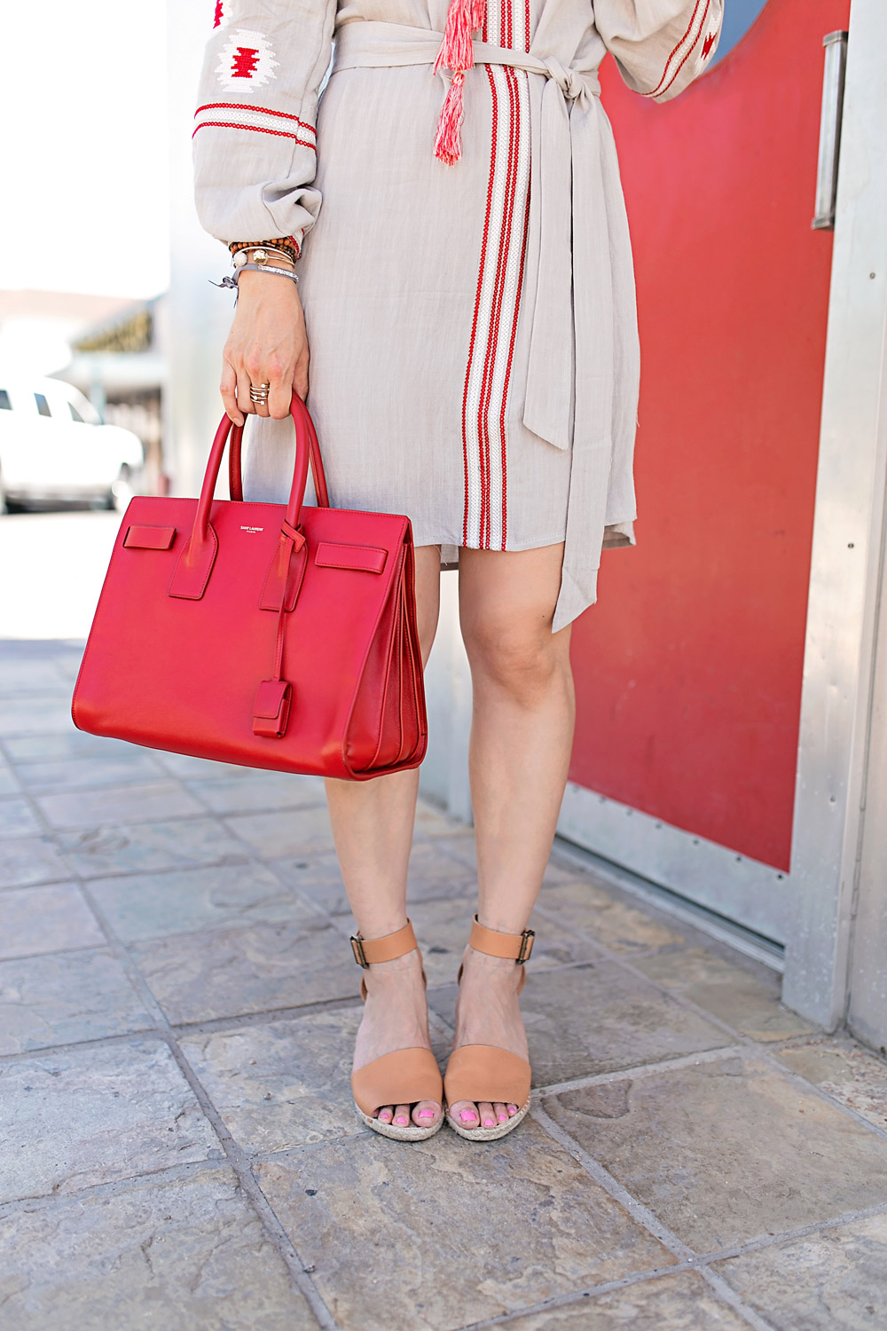 red tassel earrings and embroidered dress, saint laurent sac du jour