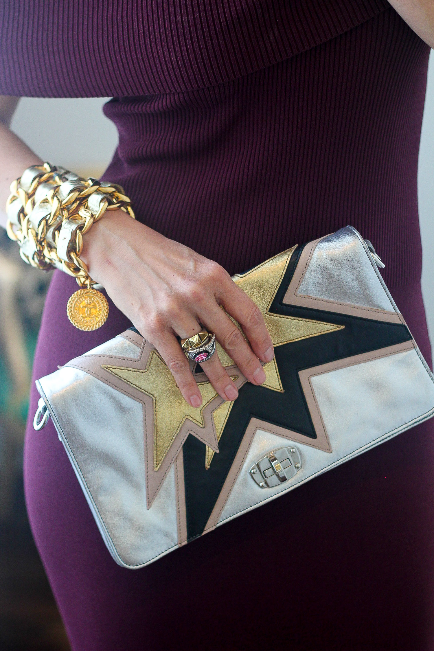 miu miu star kapow clutch and chanel belt worn as bracelet