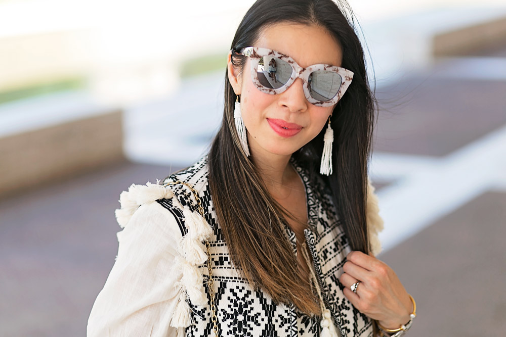 sea new york tassel statement vest, quay sugar and spice sunglasses, white tassel earrings