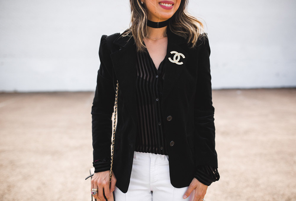 paige linara velvet top with black velvet blazer and white flare jeans, chanel brooch, forty something fashion