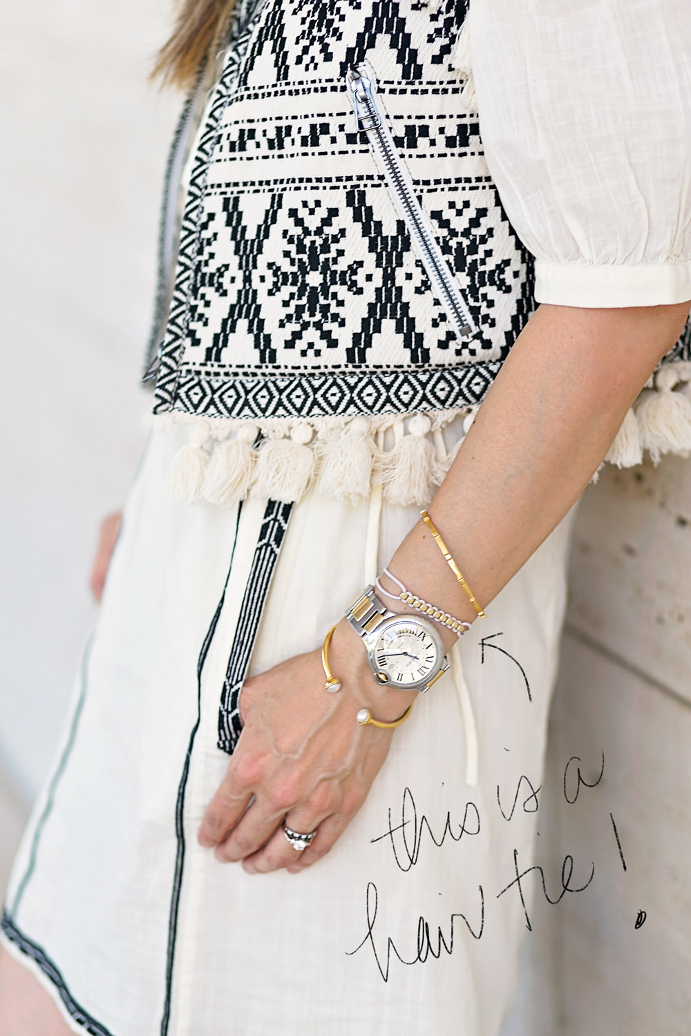 embroidered tassel vest with cartier ballon bleu watch hair tie bracelet accessories detail