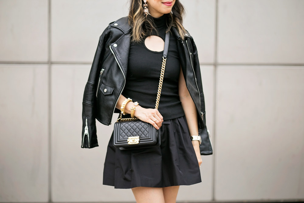 black beaufille keyhole turtleneck, miu miu faille skirt, moto jacket, chanel boy bag