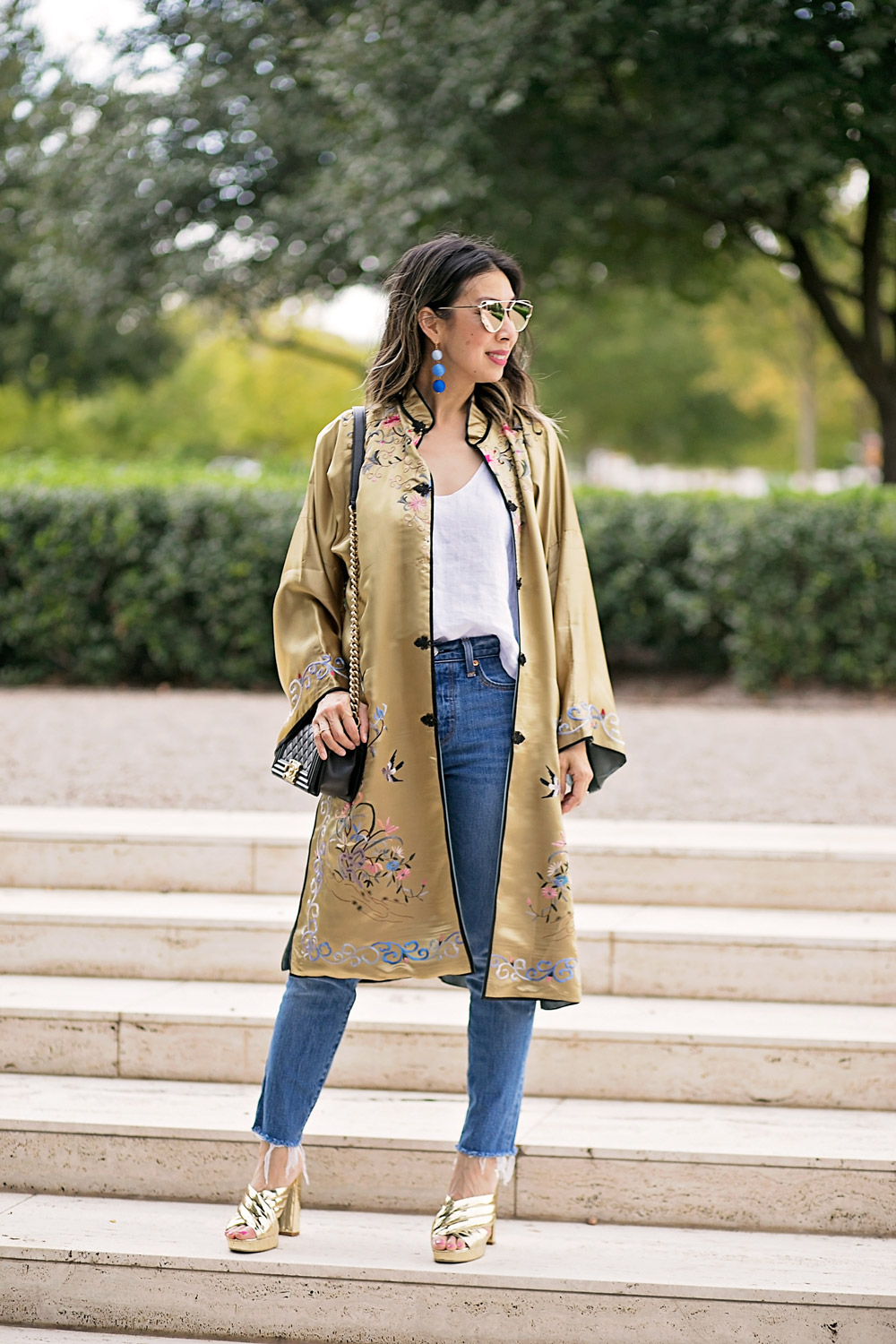 gold embroidered asian robe with white tank and levi's mom jeans