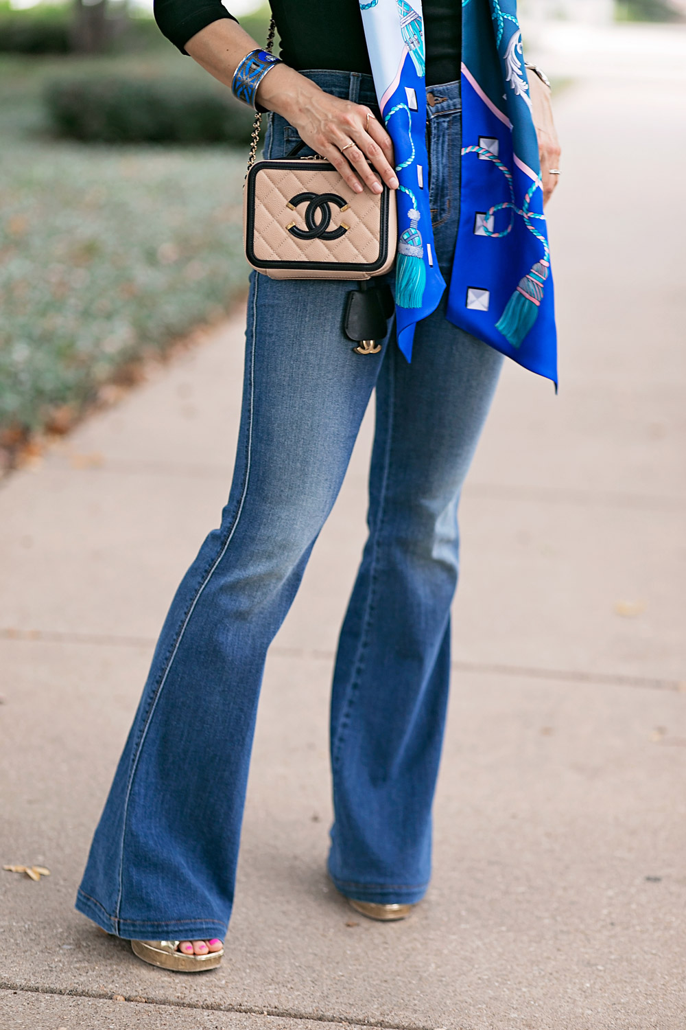 black top, flare jeans and chanel filigree vanity bag