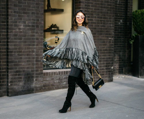who what wear grey fringe poncho with black otk boots, chanel brooch and boy bag