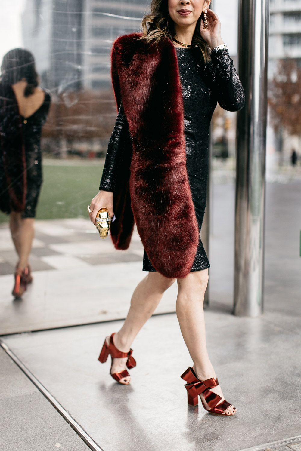 black sequin dress with burgundy fur stole and delpozo bow sandals