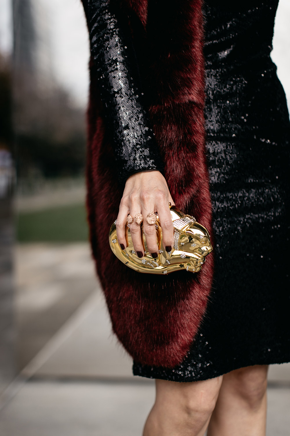 black sequin dress with burgundy fur stole and kendra scott druzy double ring
