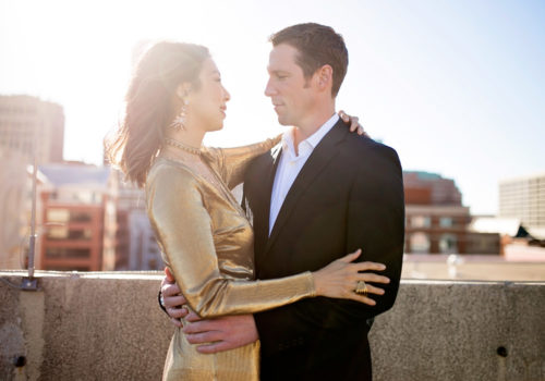 NYE gold dress, glamorous couple