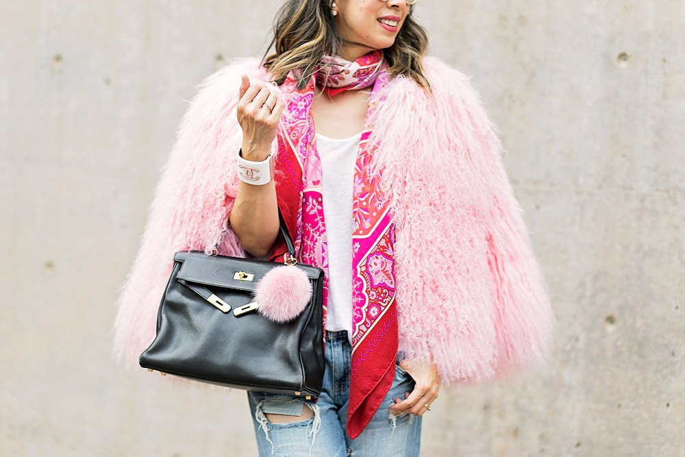 charlotte simone pink fur jacket with hermes shawl and black kelly bag