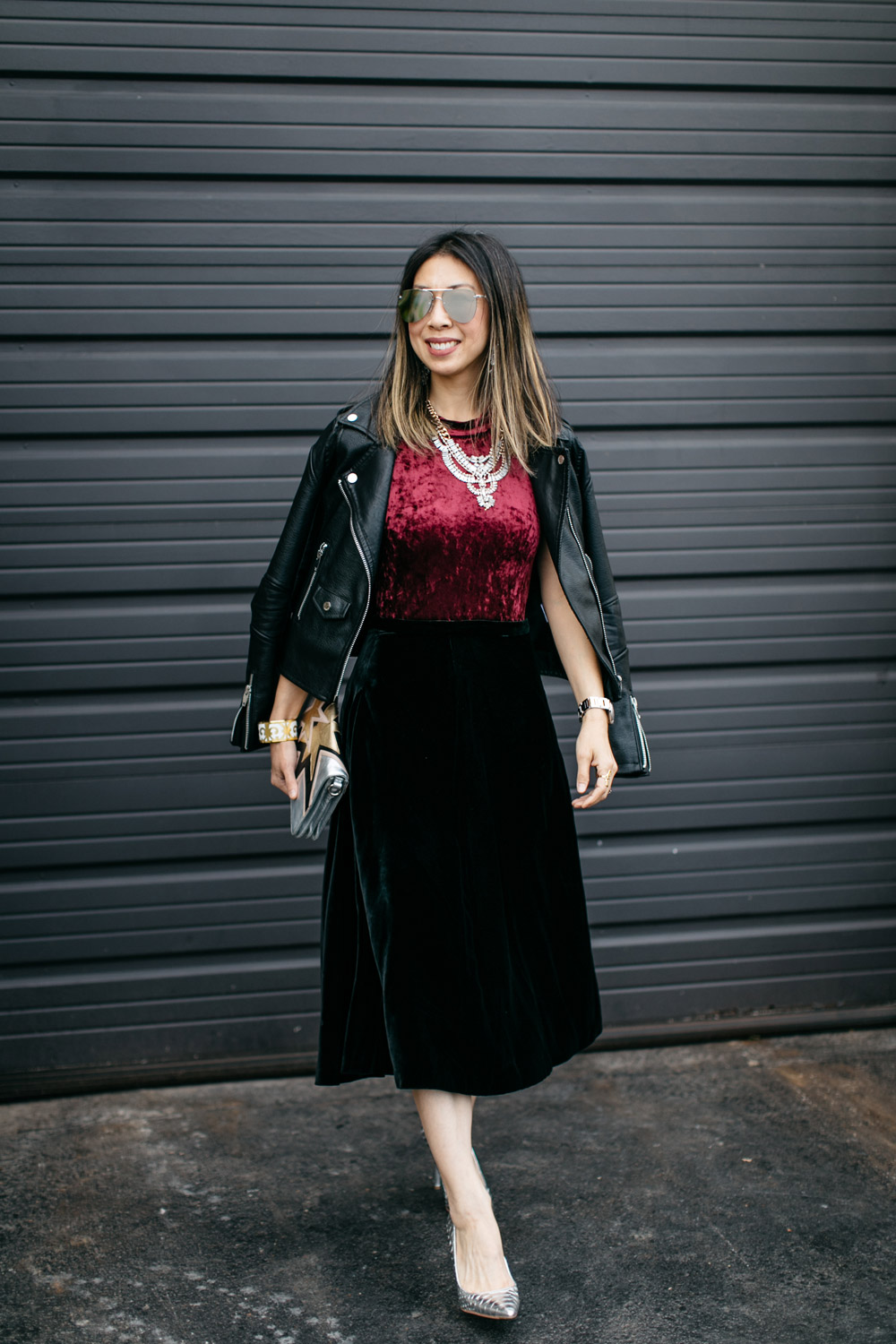 easy holiday outfit, burgundy velvet bodysuit with black midi skirt and moto jacket, statement necklace