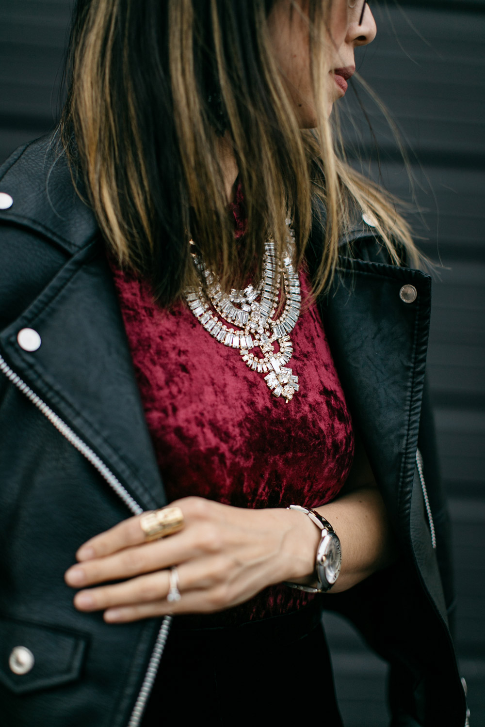 burgundy velvet bodysuit and moto jacket, T+J design statement necklace