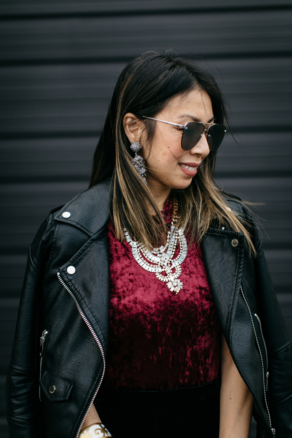easy holiday outfit, burgundy velvet bodysuit and moto jacket, T+J design statement necklace, sachin and babi grape earrings