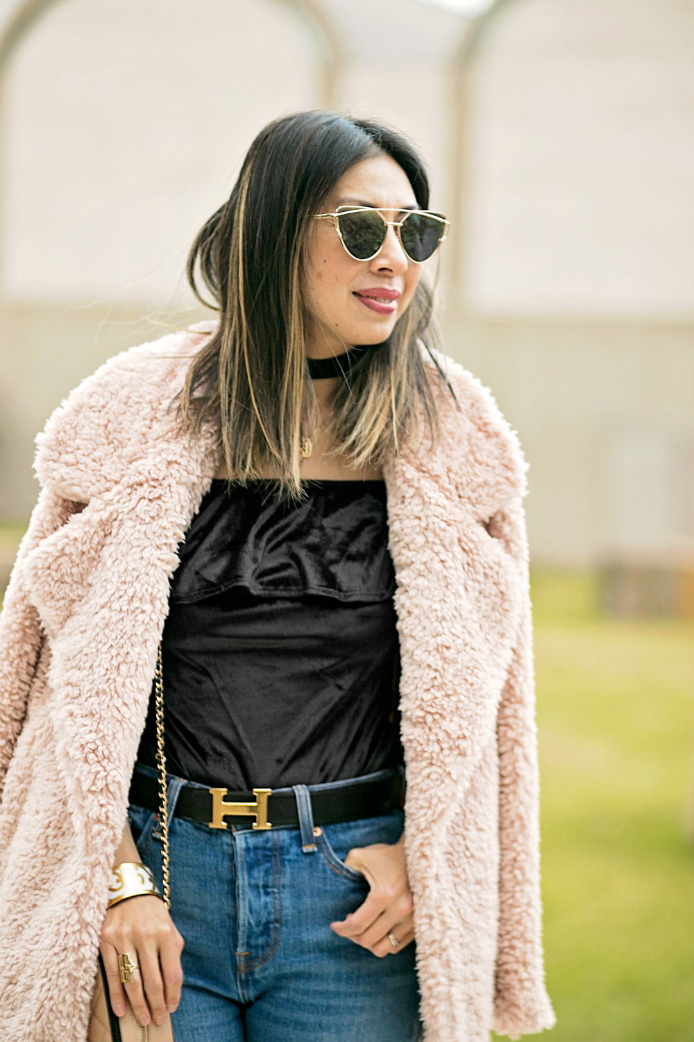 modern way to wear a monogram necklace with a choker, tularosa pink fur coat, hermes belt on high waisted jeans