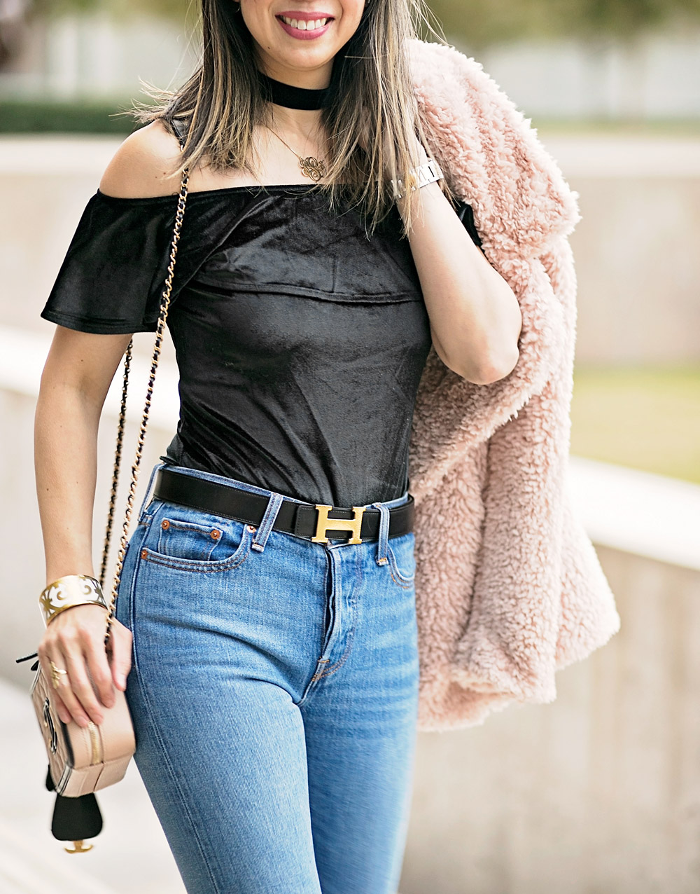 tularosa pink fur coat, velvet off the shoulder top with high waisted jeans and chanel slingbacks