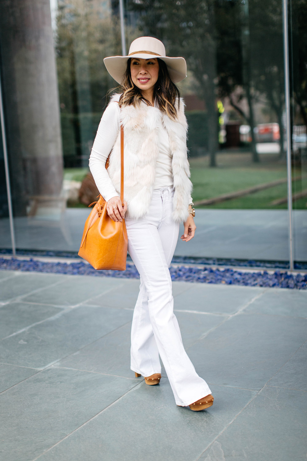 winter white outfit with flare jeans and hat, mansur gavriel bucket bag cammello