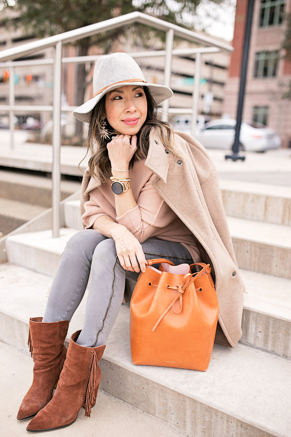 fossil q wander rose gold smartwatch, tan off the shoulder sweater with frame le skinny grey jeans, mansur gavriel bucket bag, grey fedora