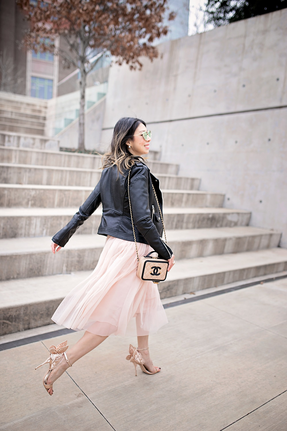 sophia webster chiara heel with pink tulle skirt, black moto jacket, chanel filigree vanity bag